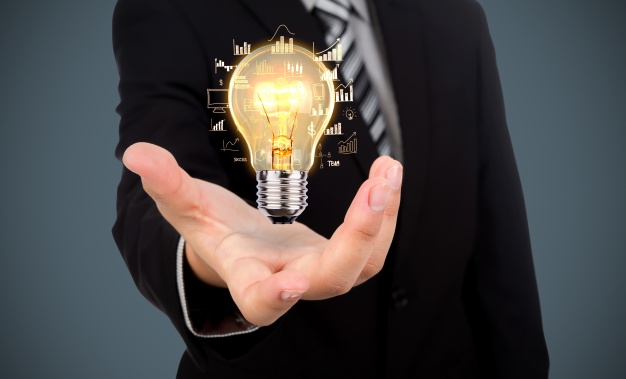 businessman-with-light-bulb-his-hand_1232-891