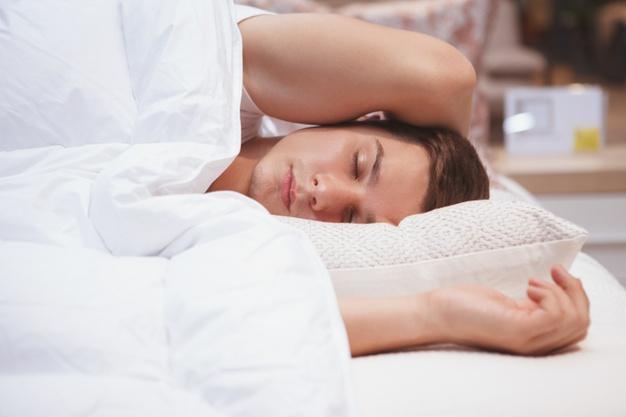 cloe-up-young-man-sleeping-his-bed_130388-1606