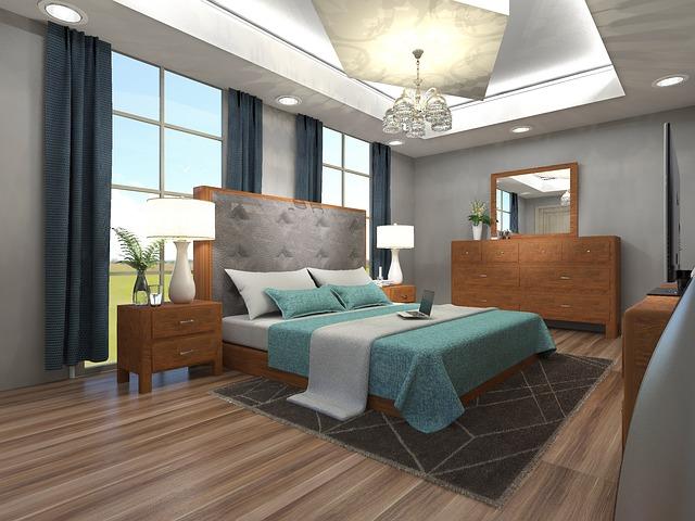 Spálňa s veľkými oknami, betónovými stenami a dreveným masívnym nábytkom.jpg